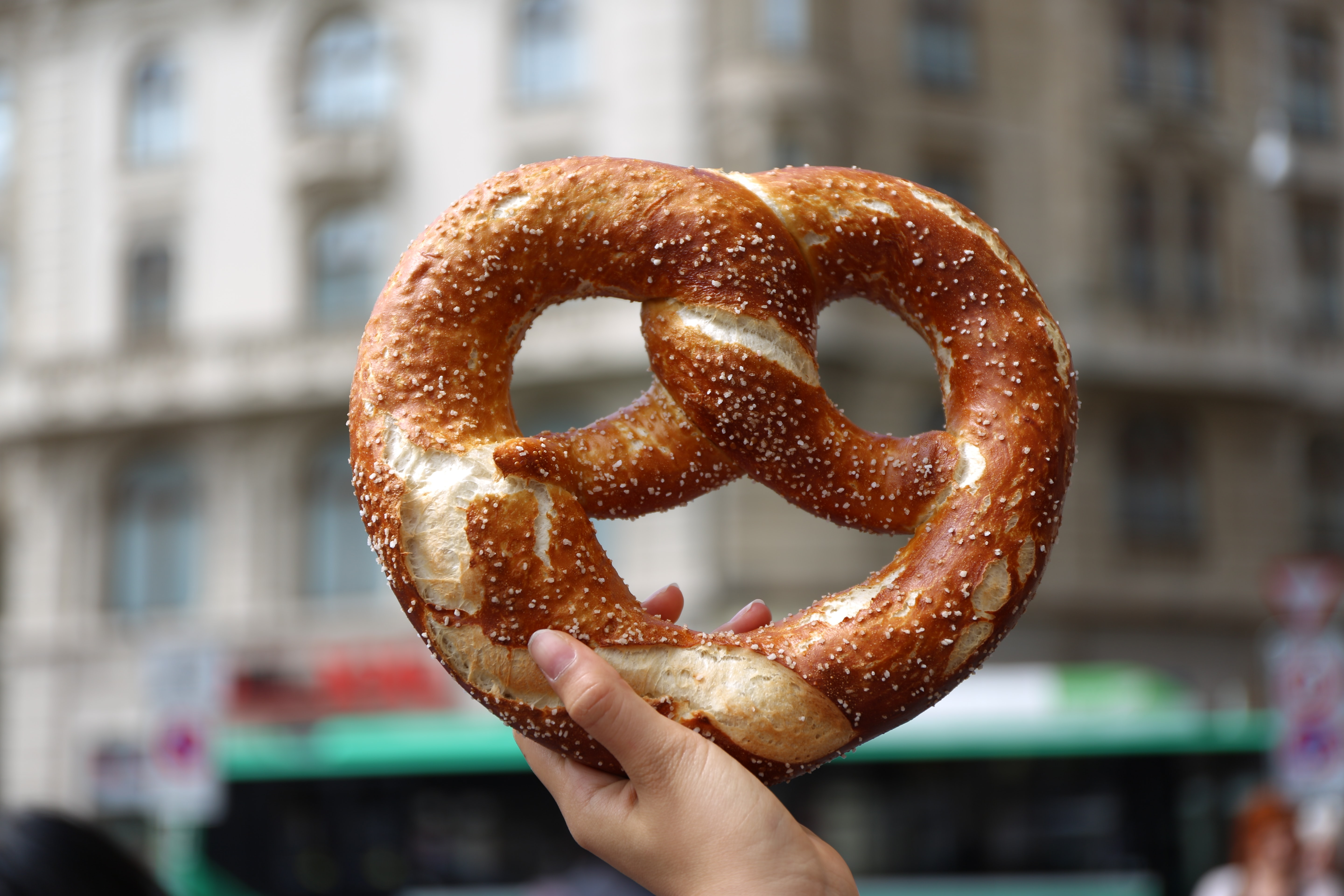 person holding pretzel