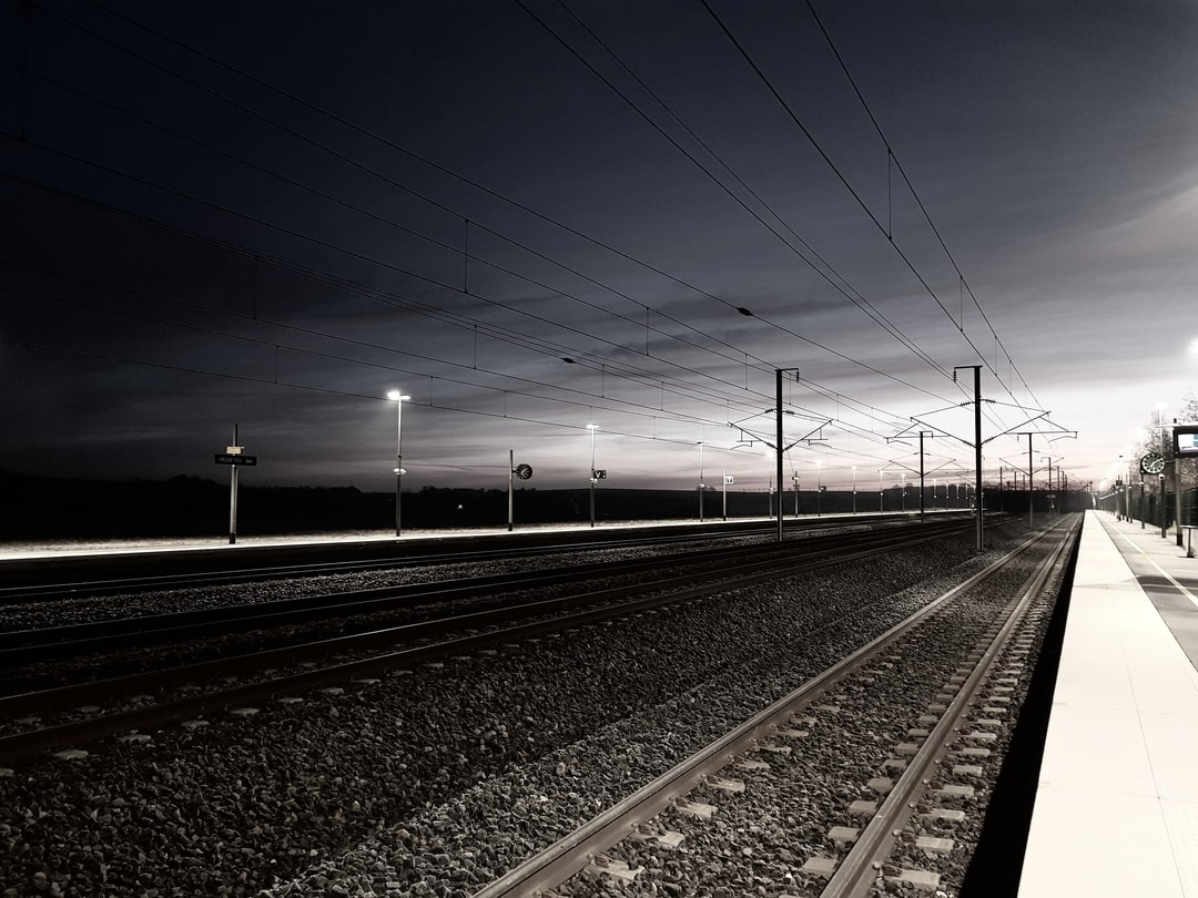 I was waiting the train in a cold fall morning. Sun was raising slowly in East direction, from where train was supposed to arrive. All lines were pushing my eyes in that direction. Taking the picture was obvious.