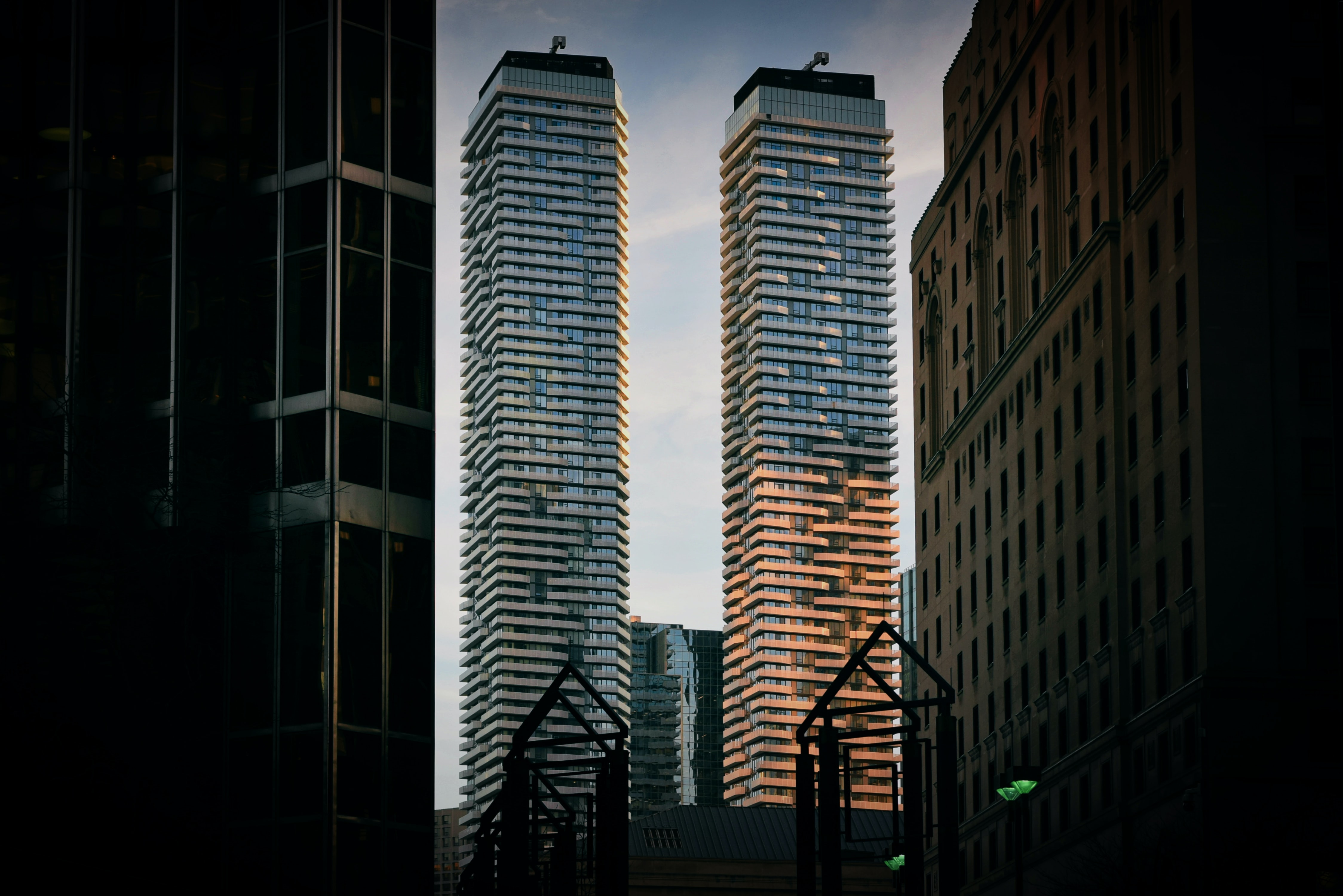 two gray concrete high-rise building at daytime