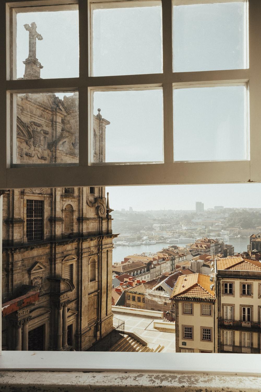 opened white wood-framed glass window