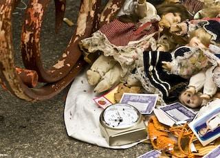 dolls beside wagon wheel