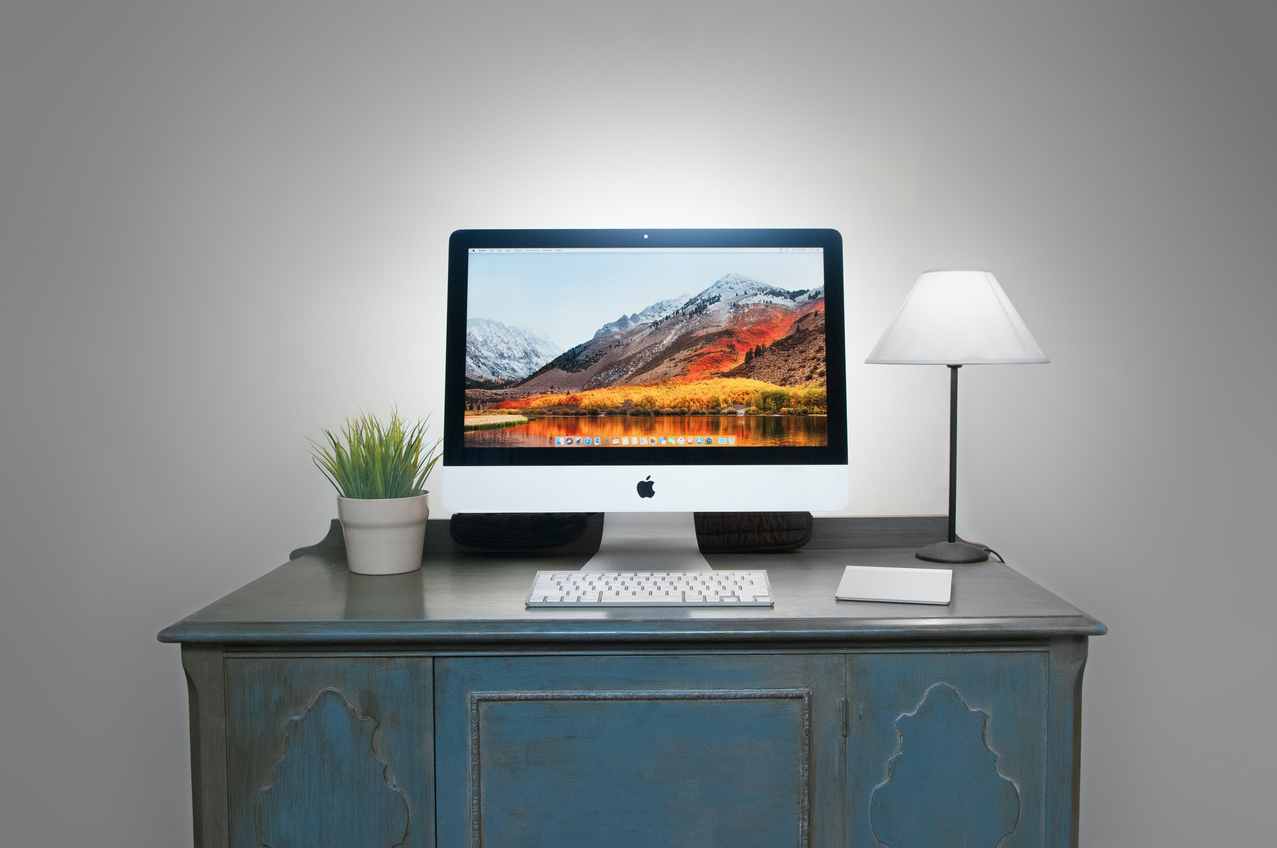 silver iMac and Apple Magic Keyboard on table