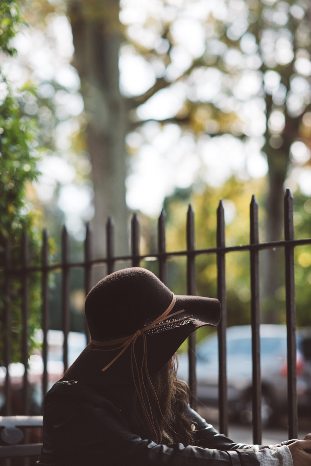 woman looking through the fence during daytime
