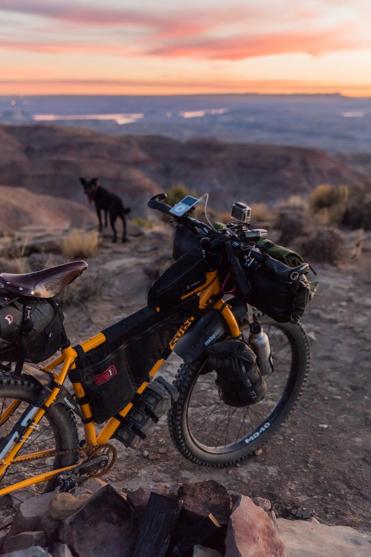 yellow bicycle on mountain