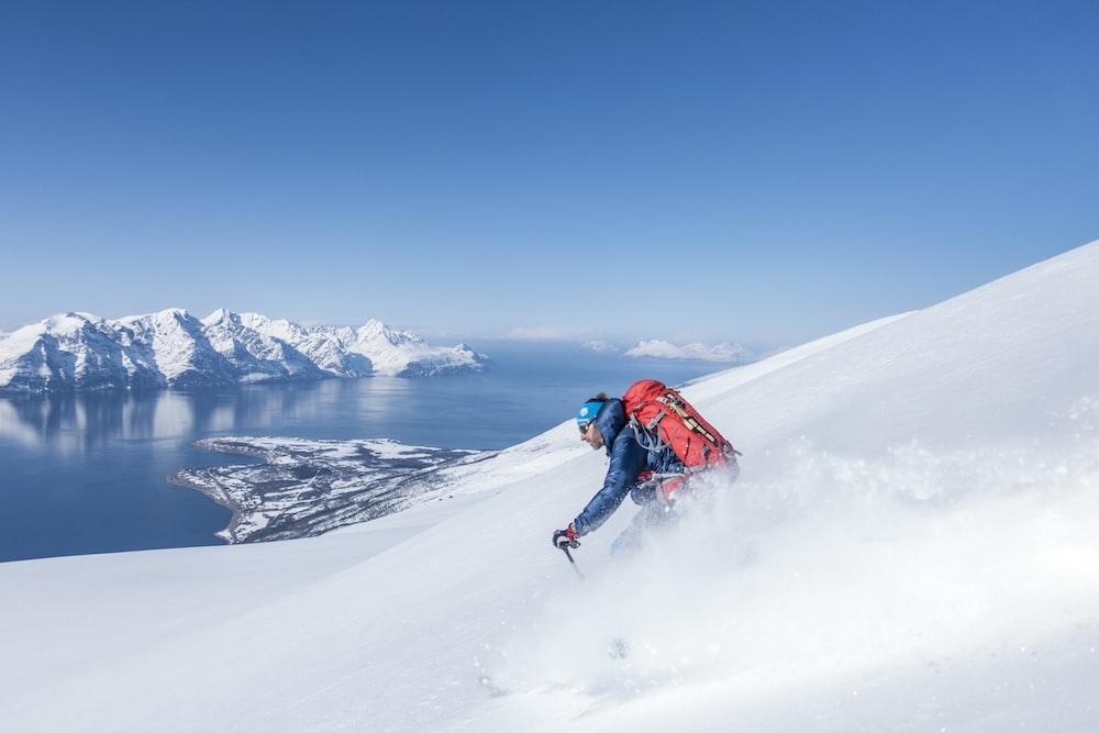 man snow boarding on the mountain