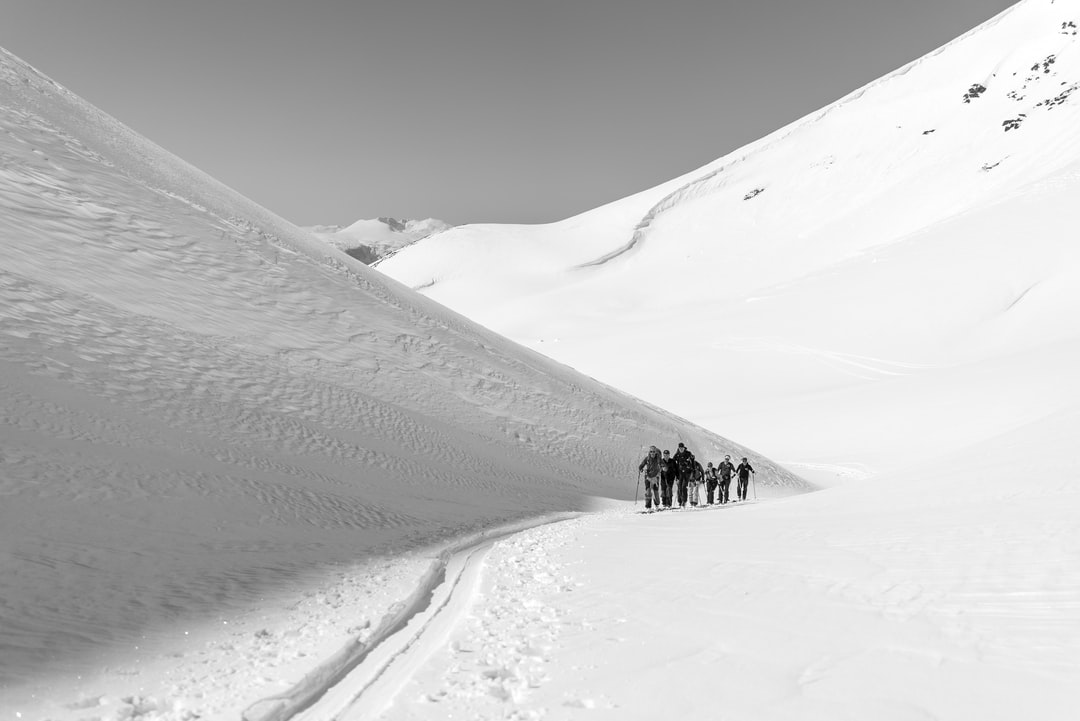 On our way to find fresh powder we skinned up this beautiful little depression between two hills. Together with the snow and shapes of the mountains it made for an exceptionally beautiful image.