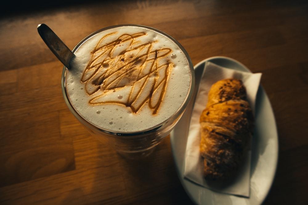 coffee beside baked bread on tabletop