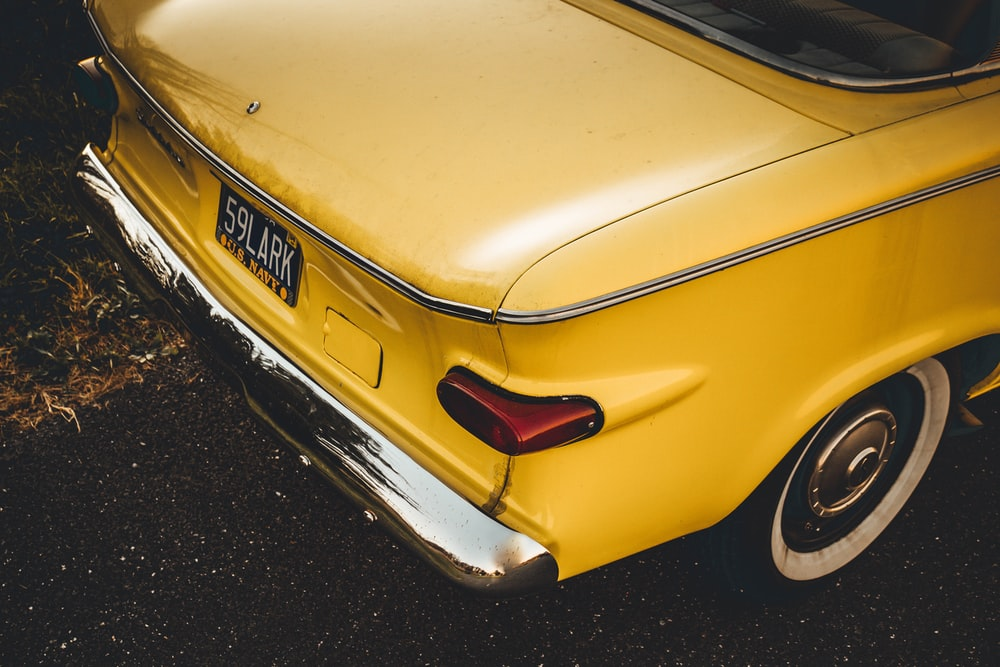 close up photography of yellow vehicle
