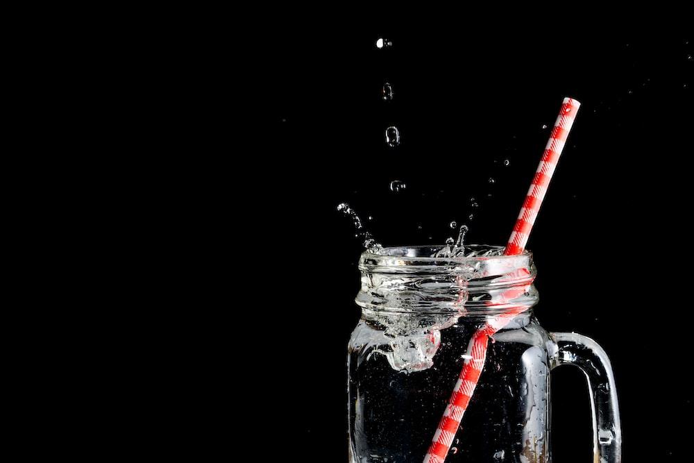 clear glass mason jar with straw