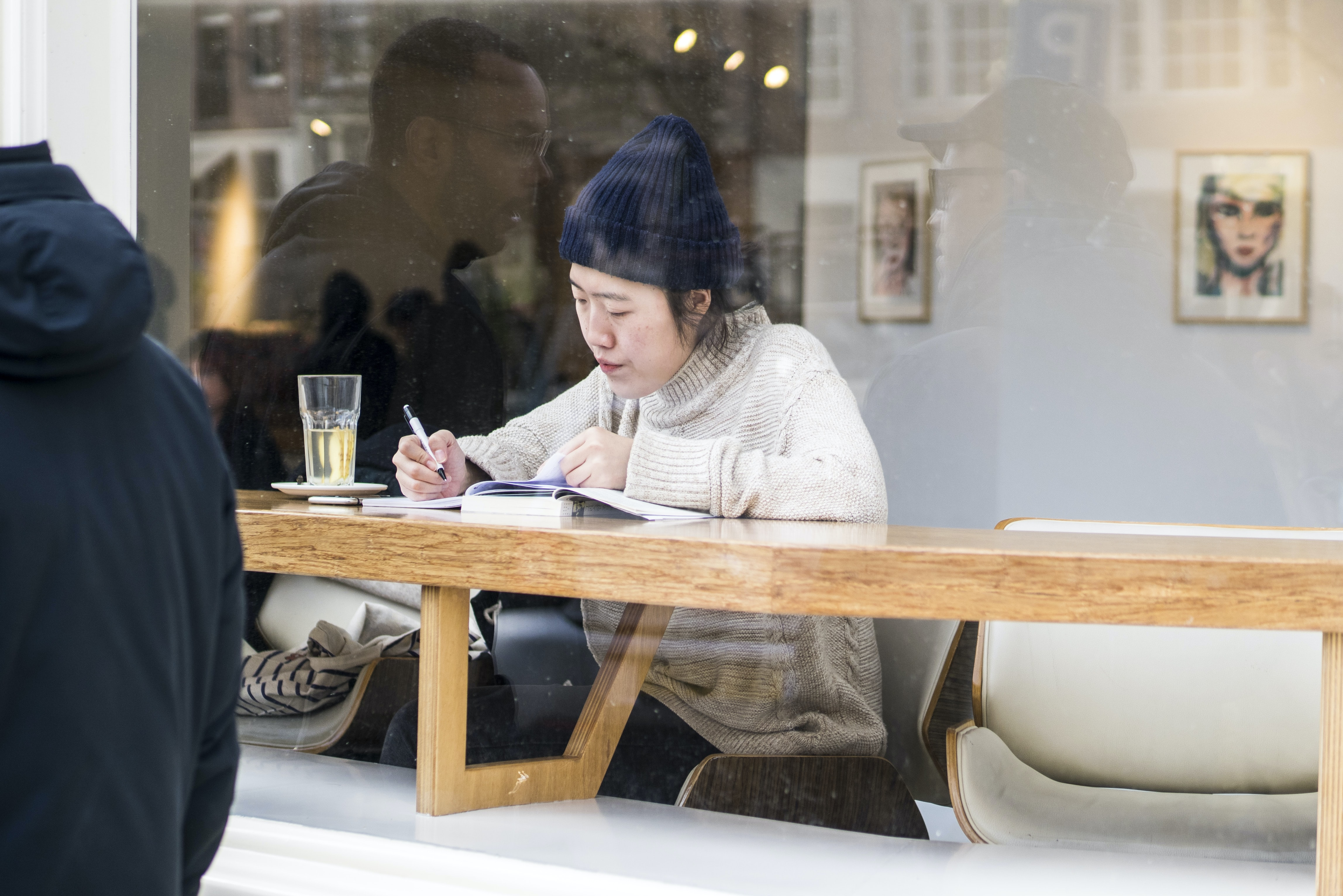 woman sitting in front of wooden table