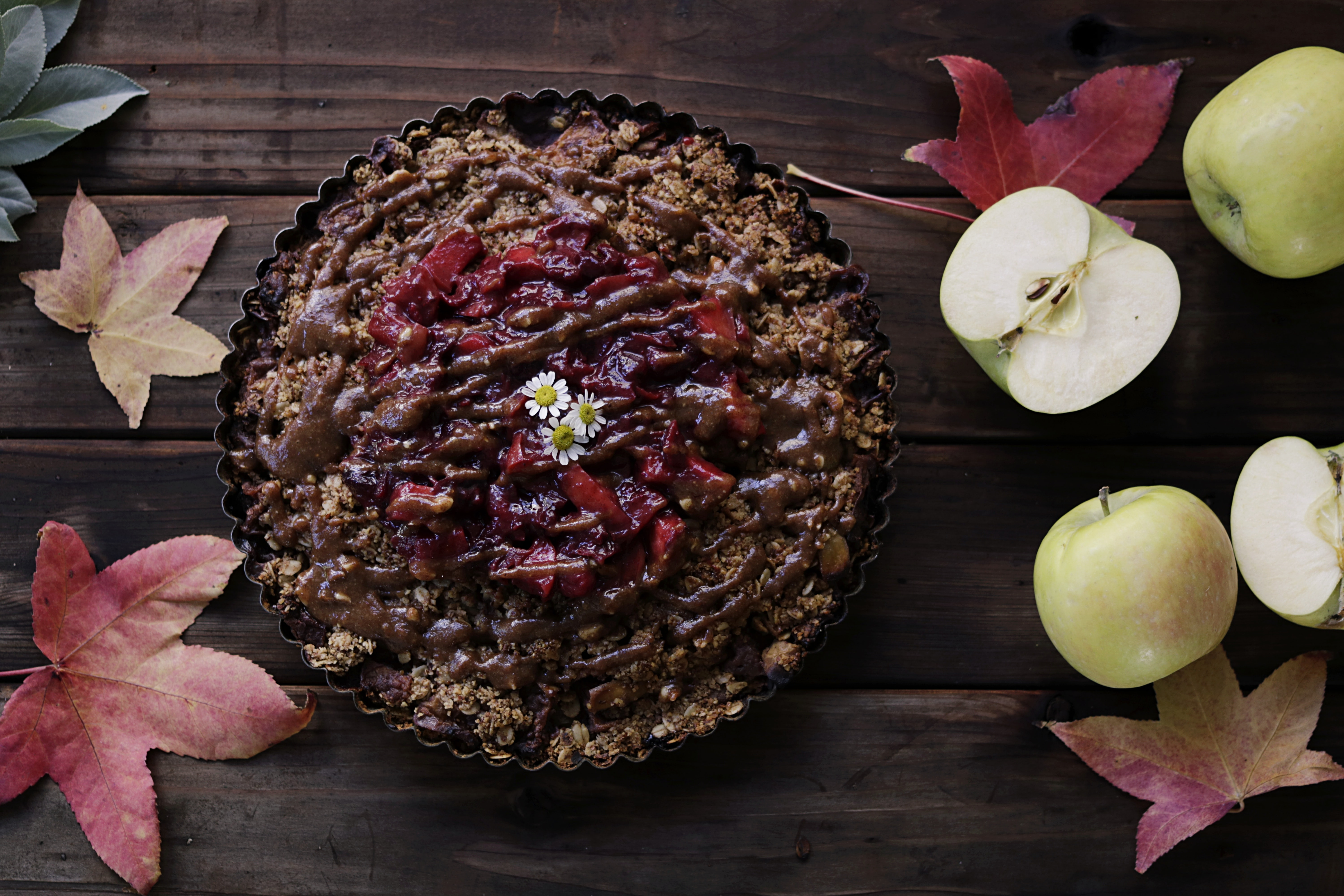 baked pastry on brown wooden surface beside sliced apples