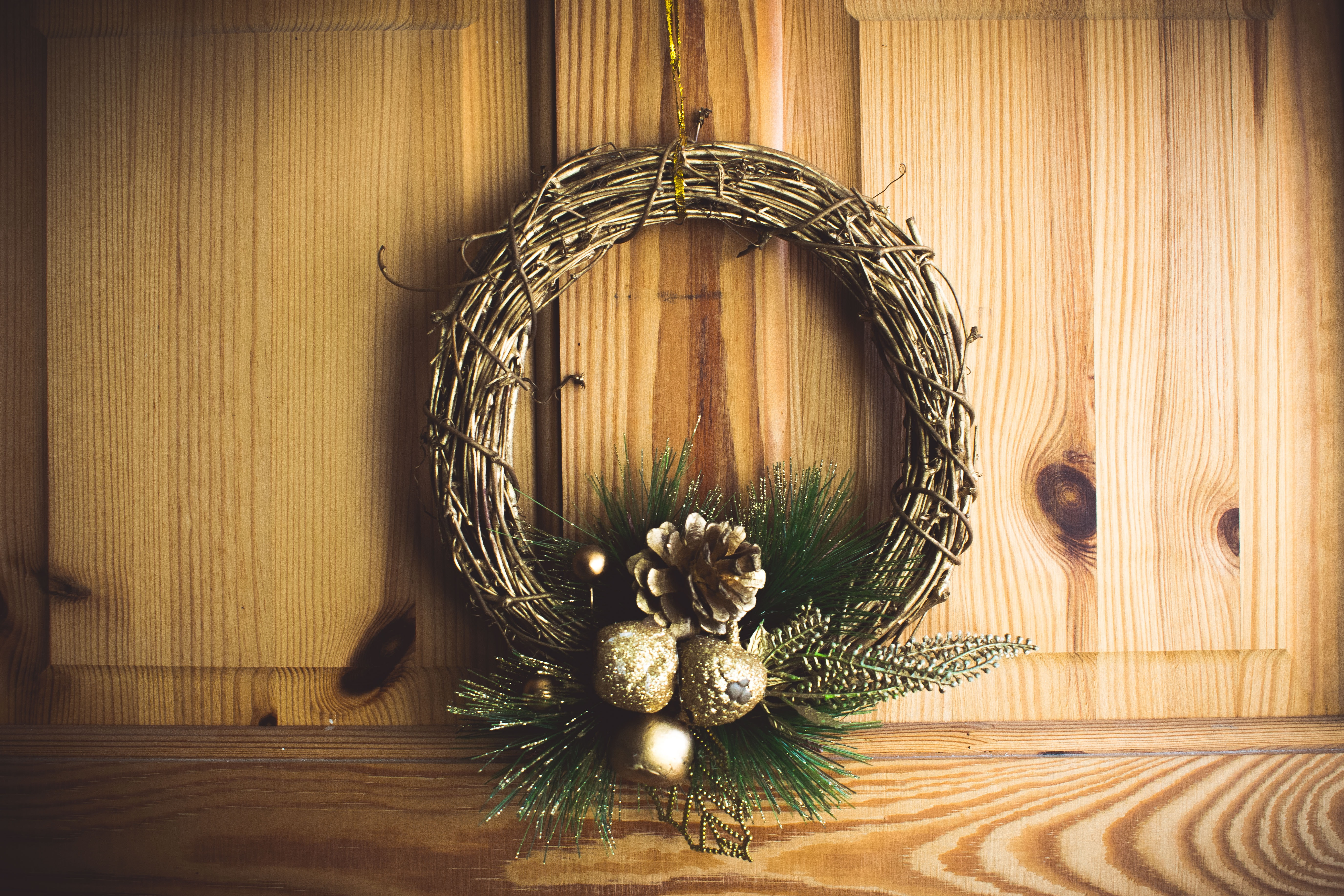 brown twig wreath on brown wooden wall