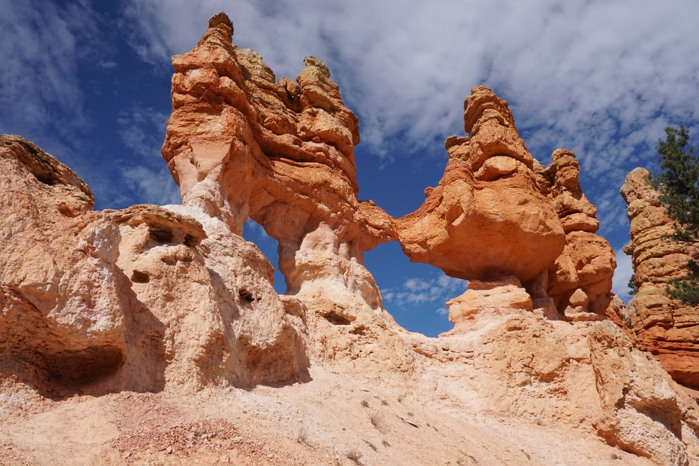 rock formation under blue and white cloudy sky photo – Free Bryce canyon  Image on Unsplash