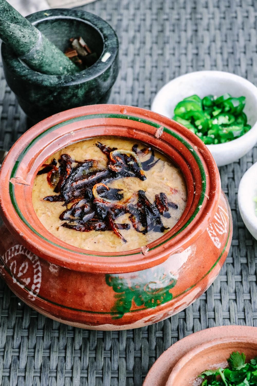 brown and black dish in ceramic pot