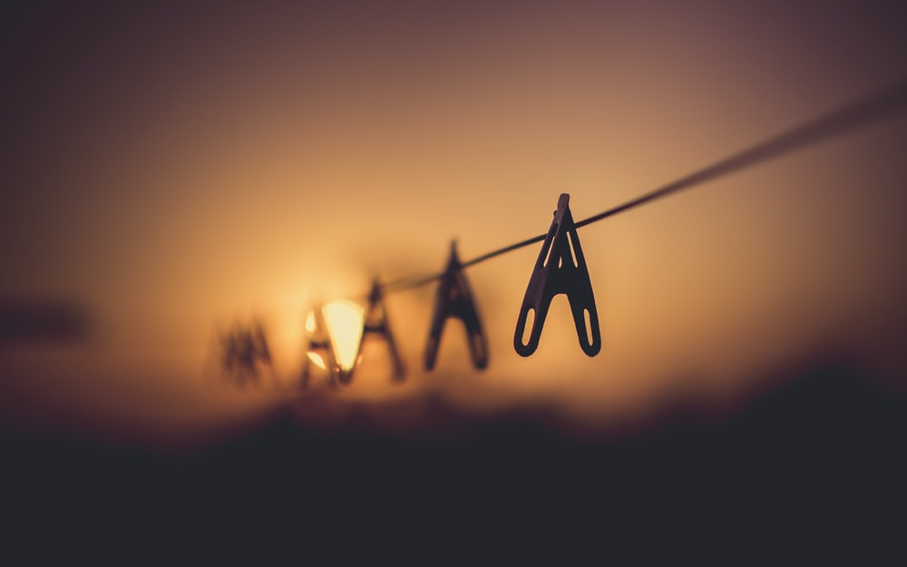 silhouette photo of cloth pegs