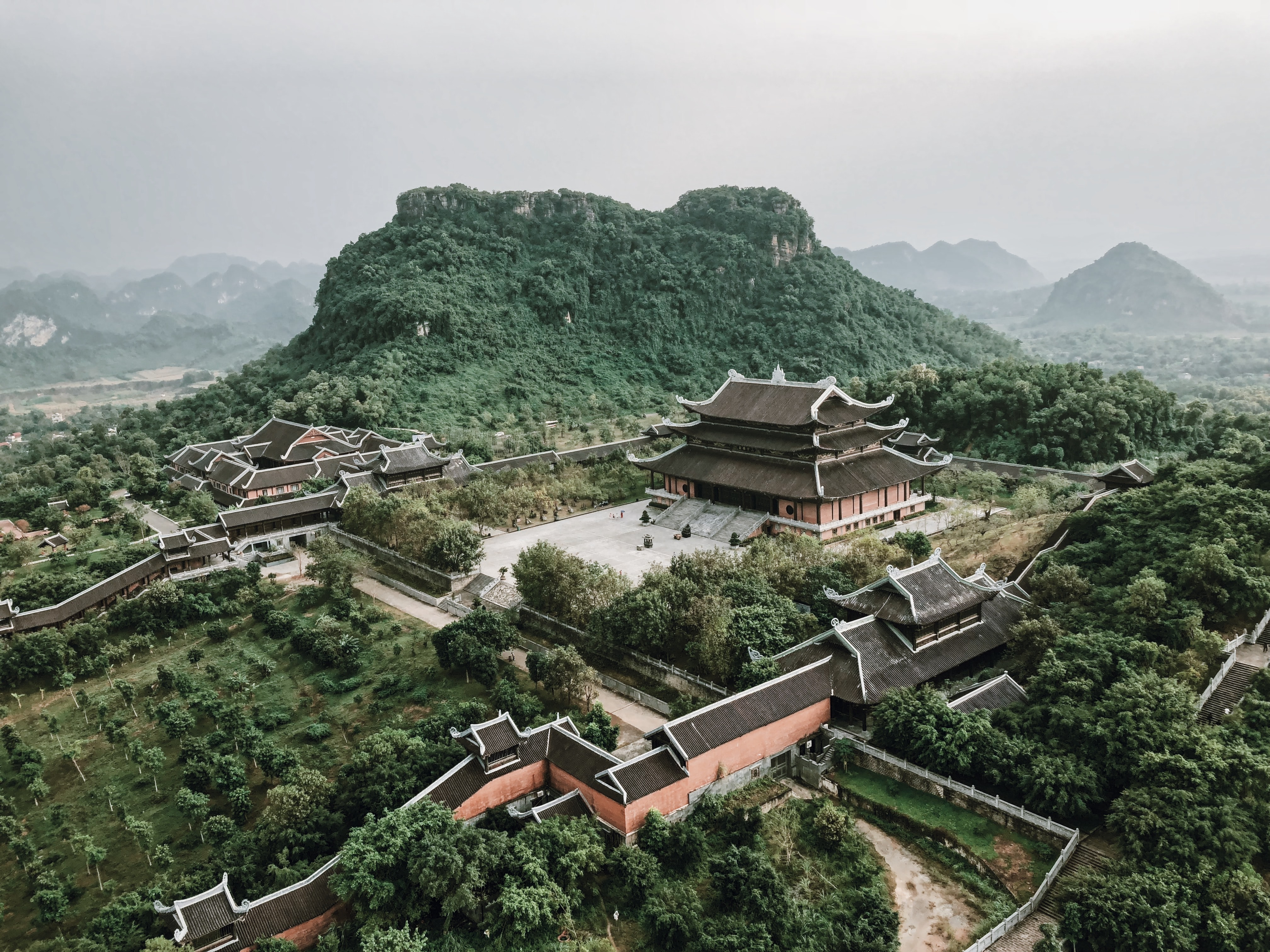 aerial shot of brown temple near mountain