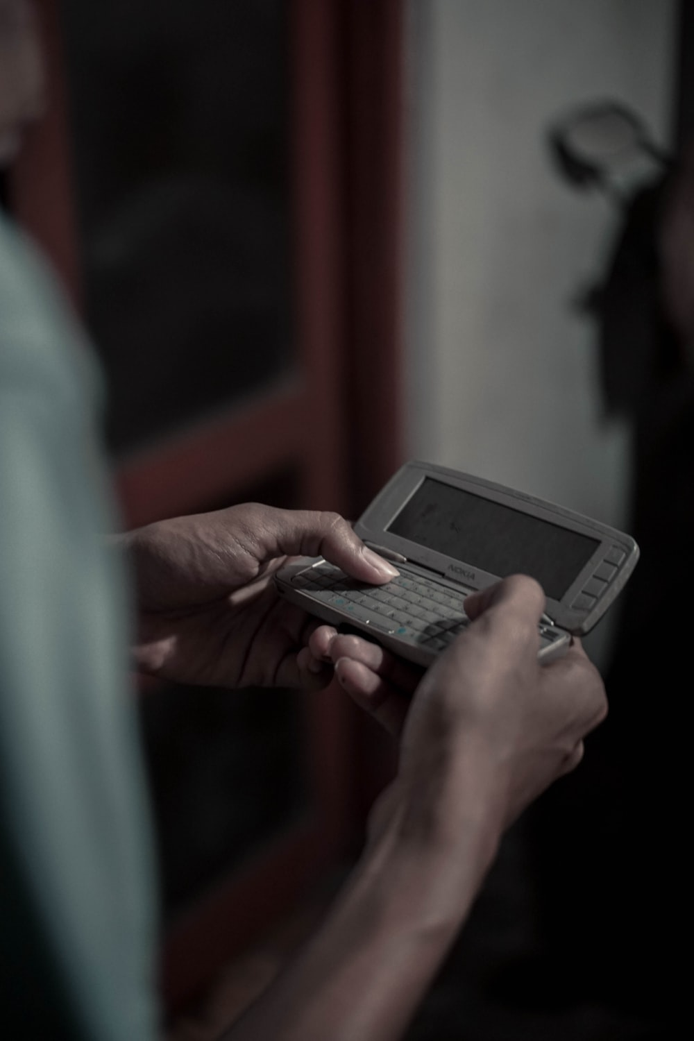 person using silver Nokia flip mobile phone