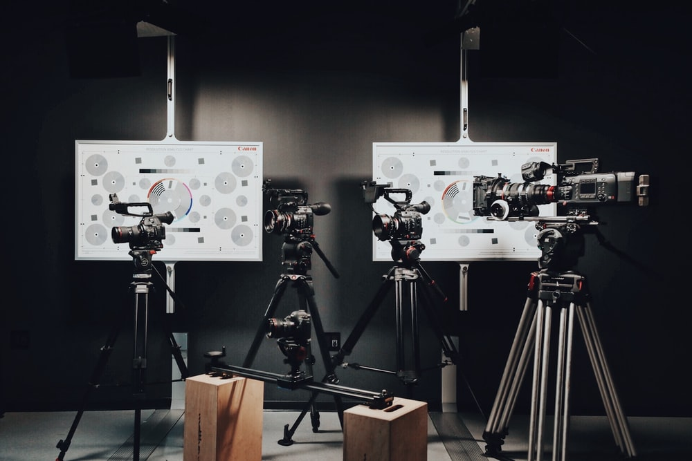 black video and DSLR cameras with tripods