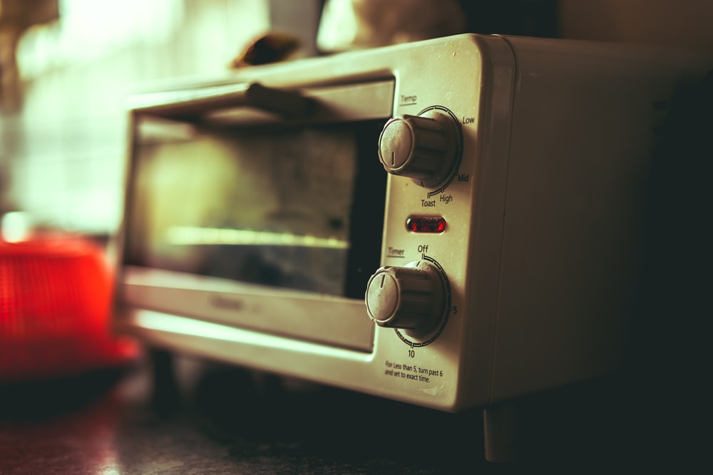 white toaster oven selective focus photography
