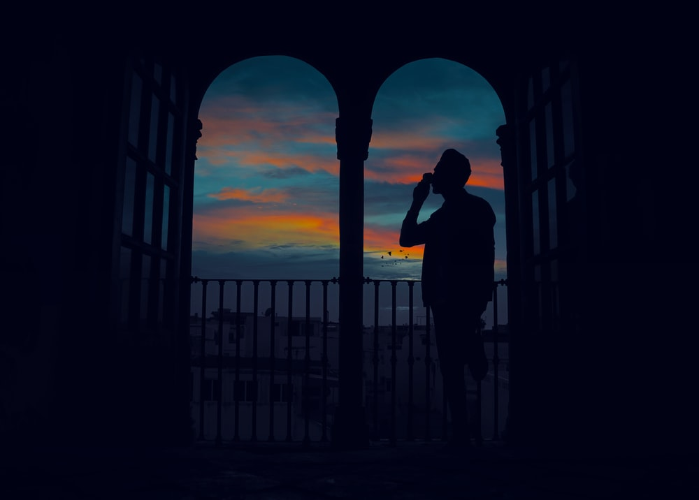 silhouette of man standing on terrace