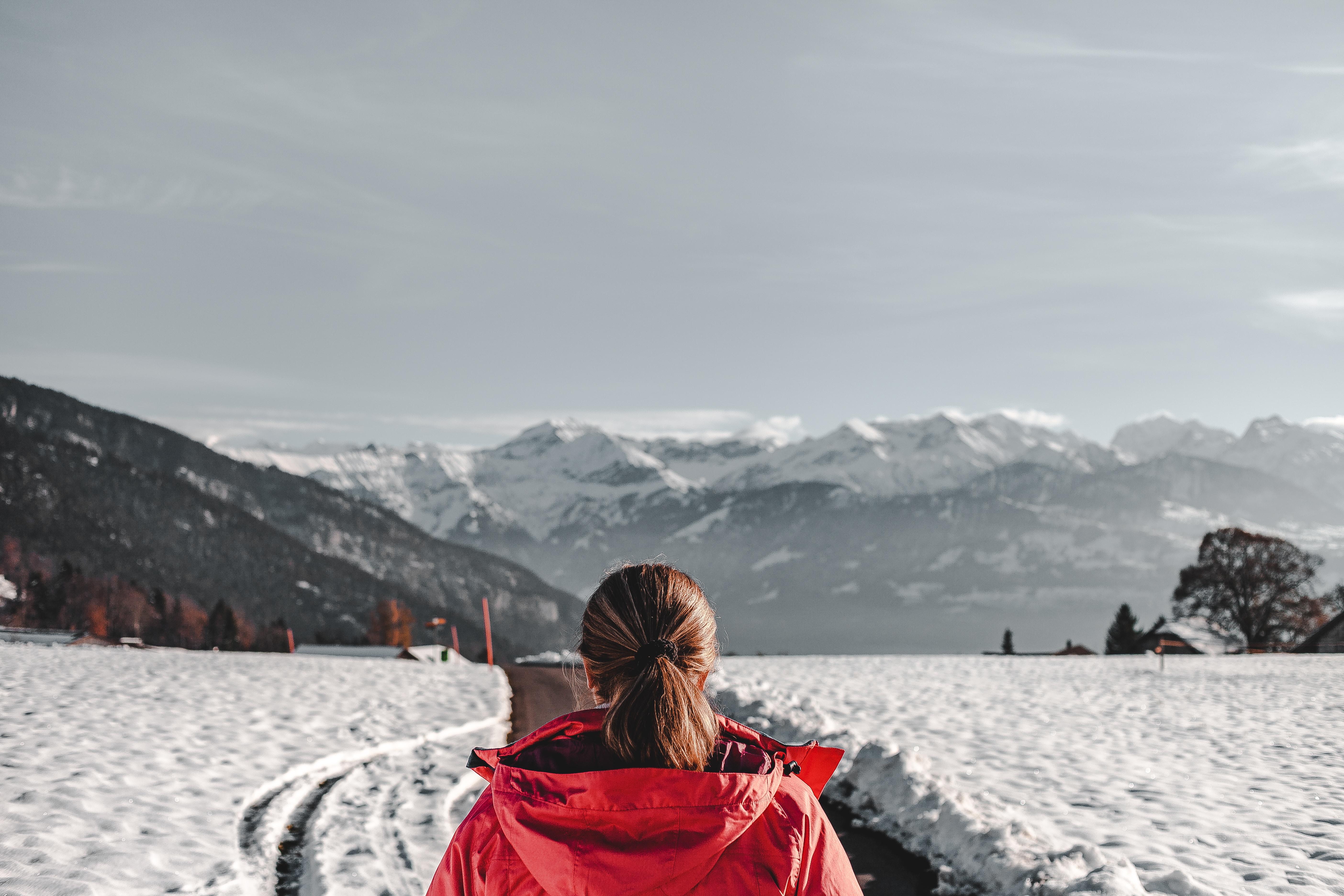 woman wearing red hoodie standing on snow