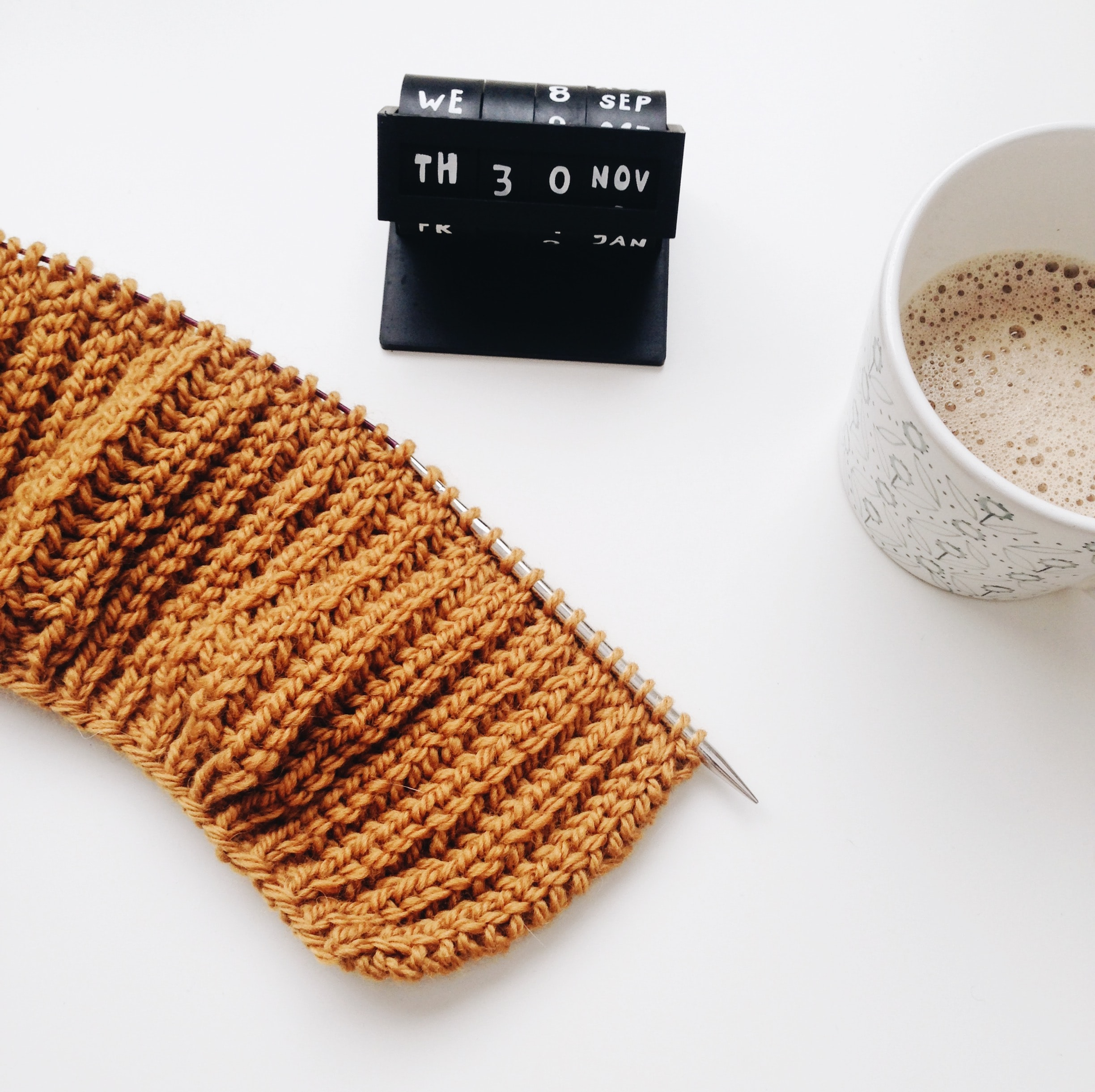 teacup beside knitted cloth