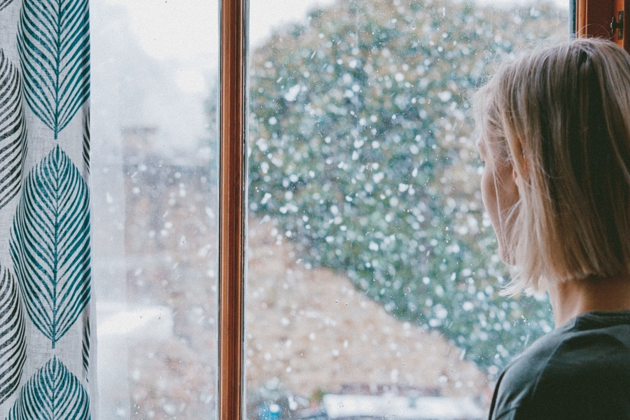 woman standing in front of clear glass window