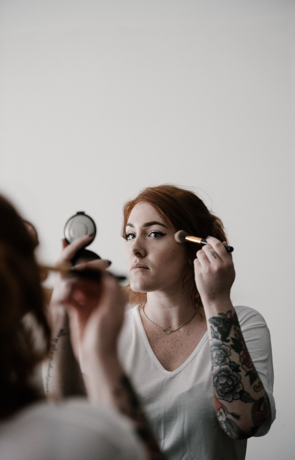 woman putting foundation on face