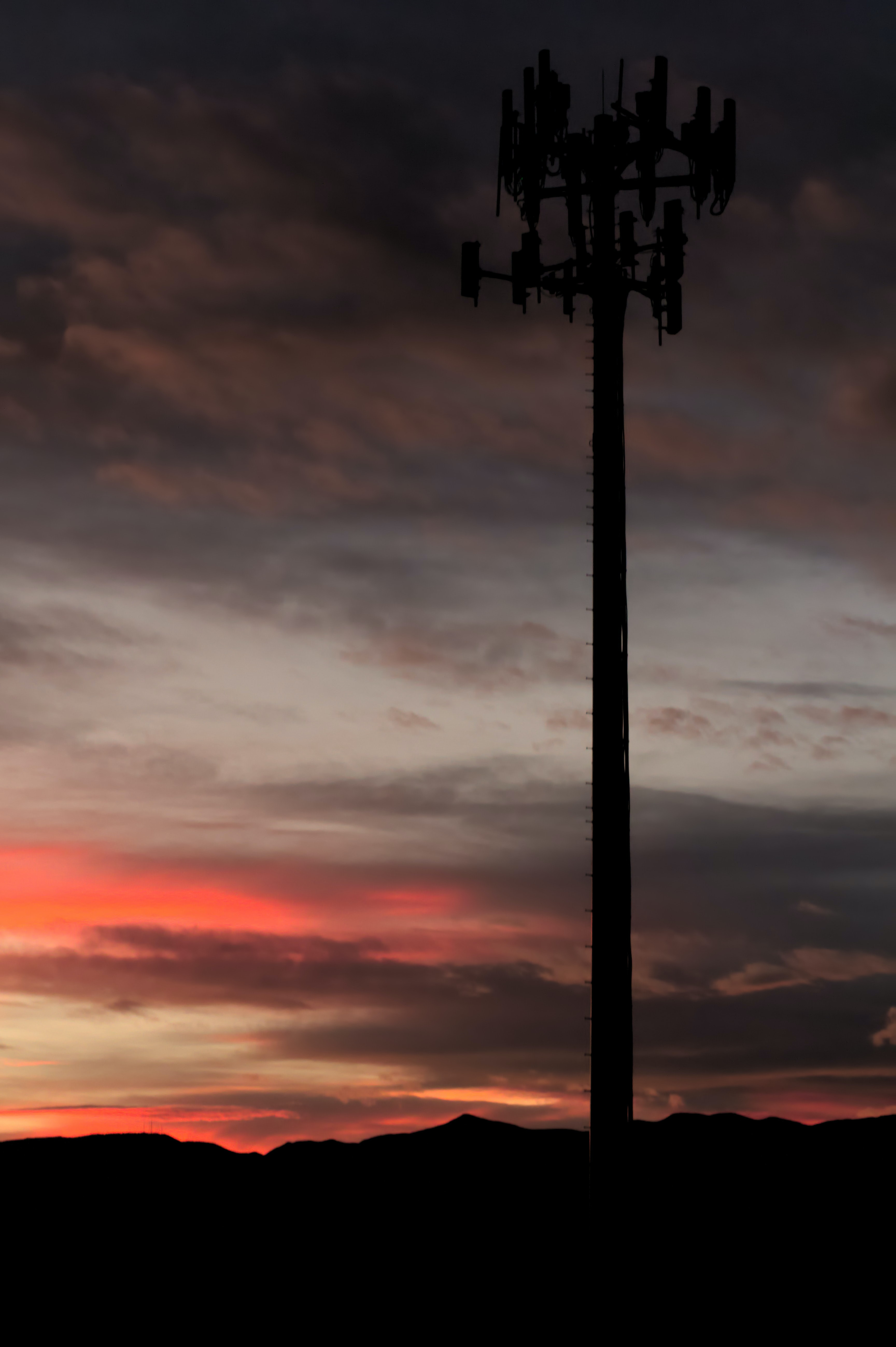 silhouette of network tower at golden hour
