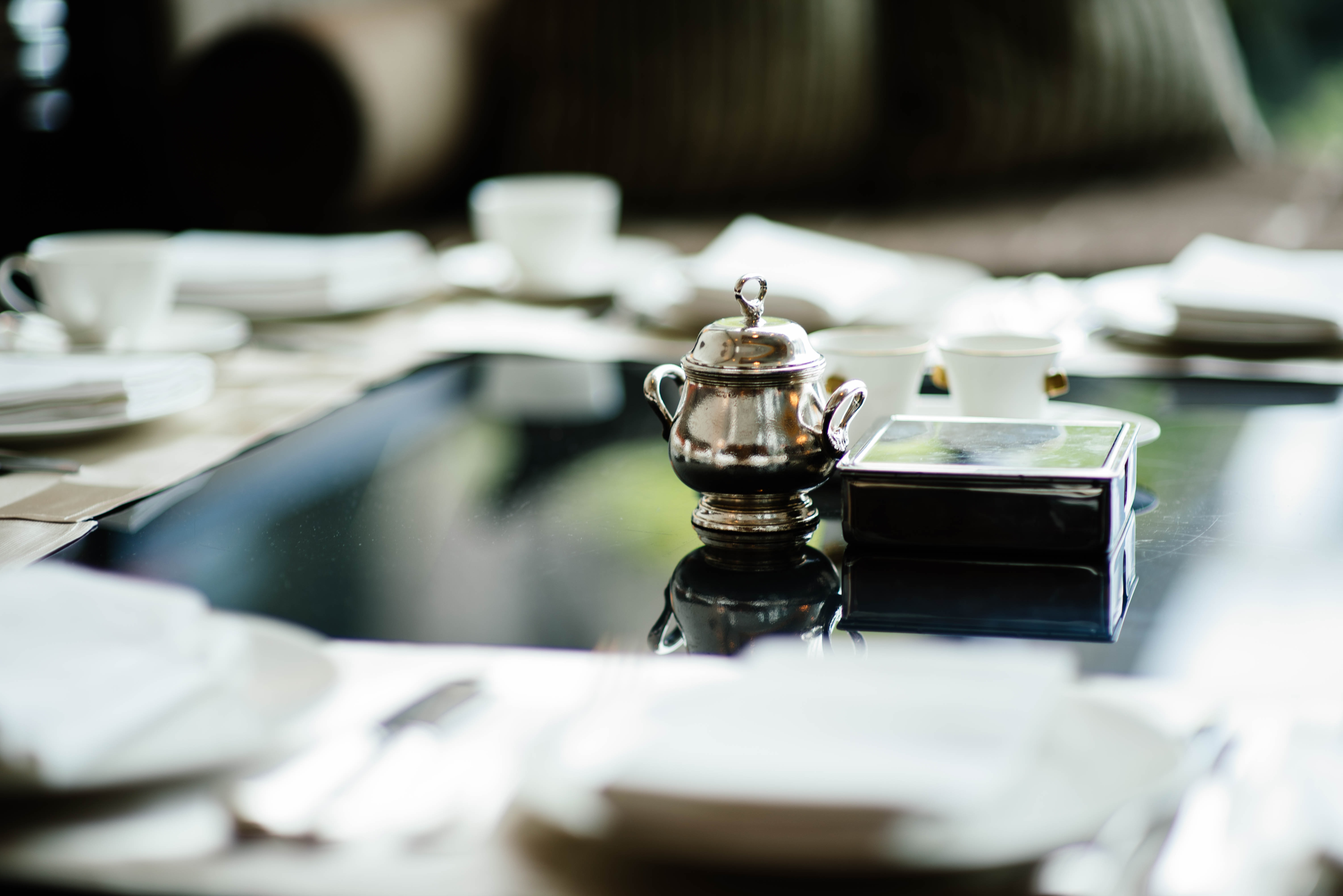 selective focus photography of teapot on table