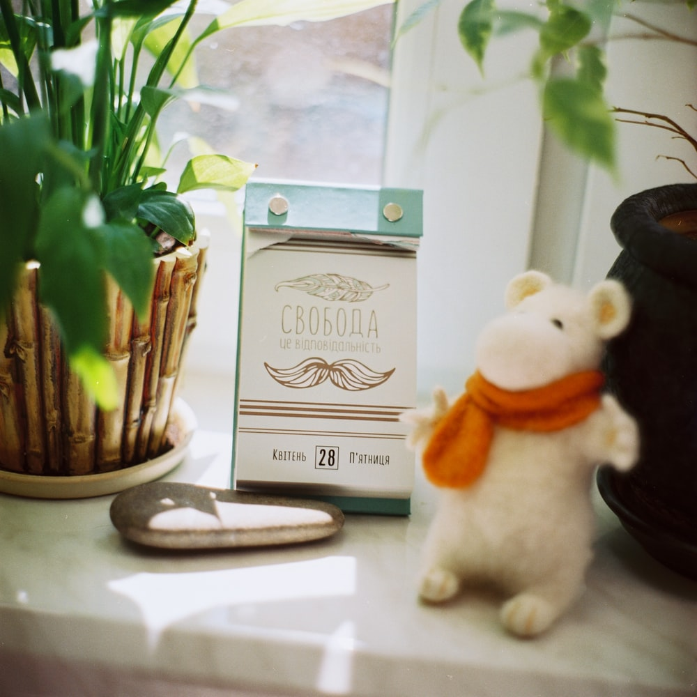 white mouse table decor near leafed plant