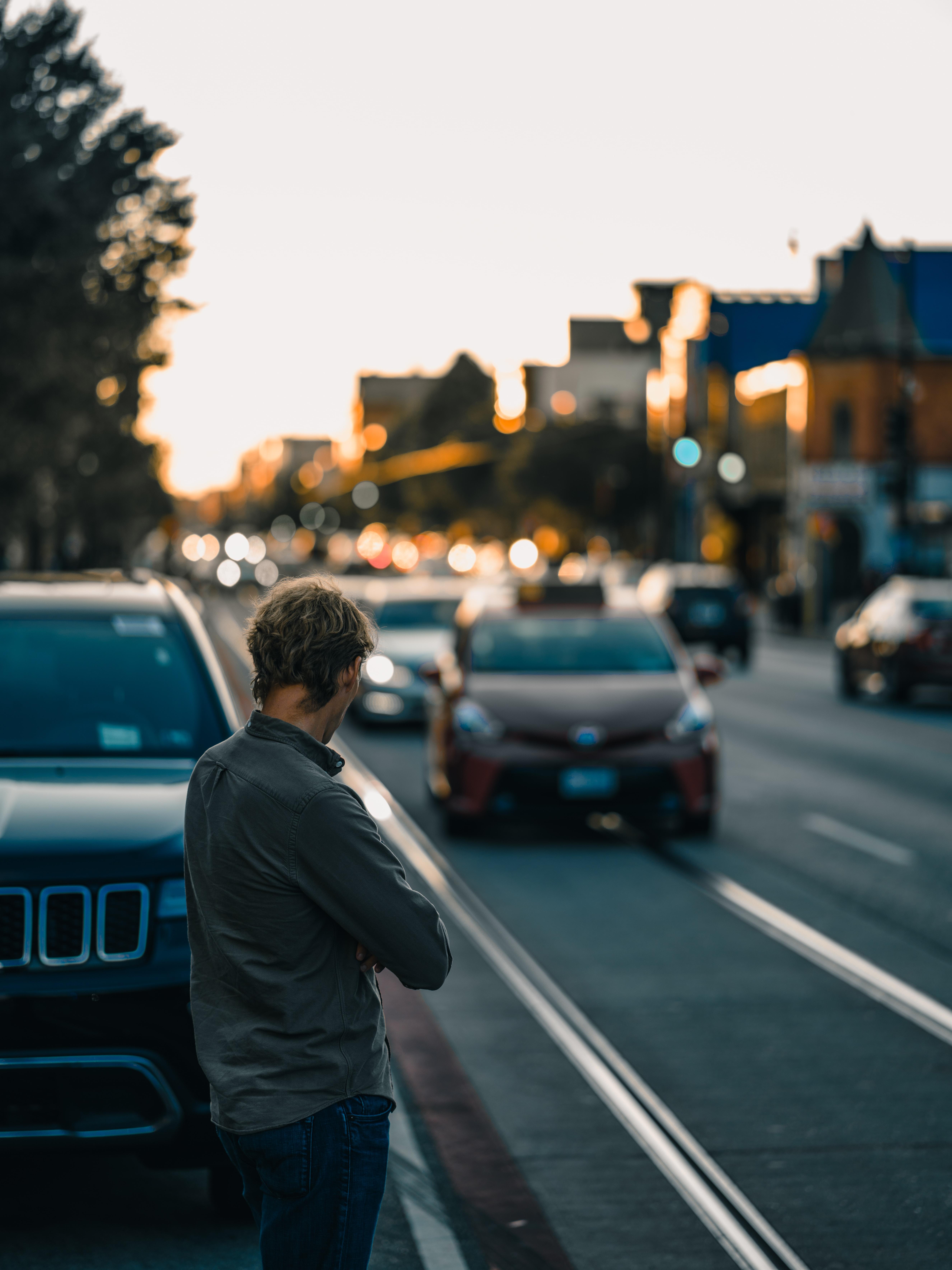 man standing near vehicle