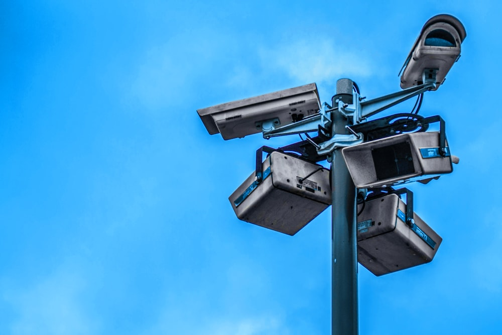 assorted white security cameras