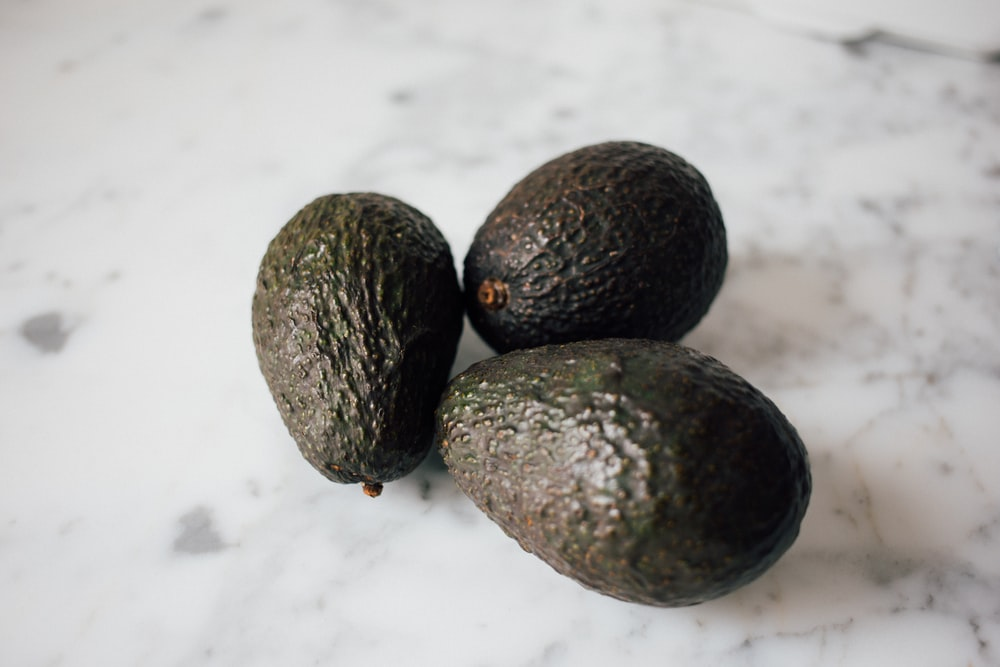 three green avocados