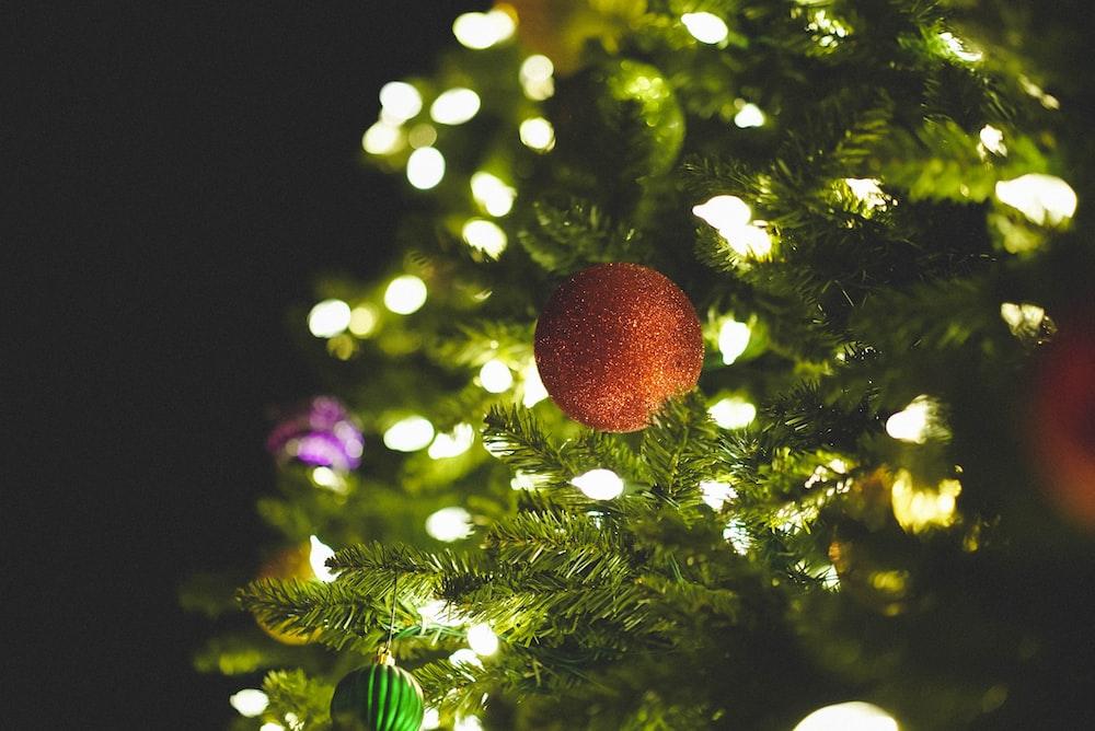 orange ball decor on green christmas tree