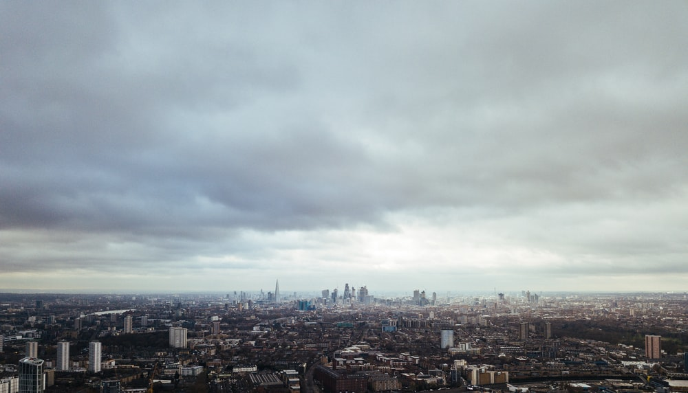 aerial photo of city during cloudy day