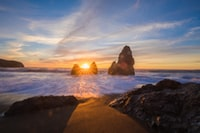 silhouette of rock formations at sunset