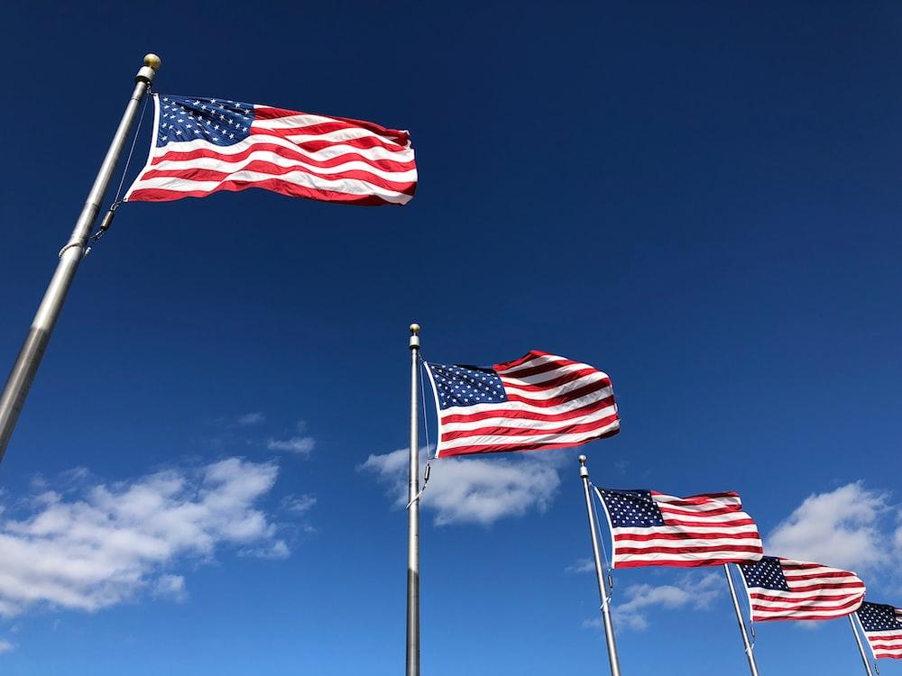 U.S. American flags under clear sky