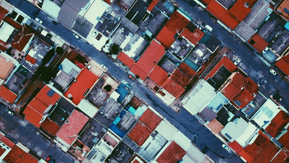 bird's eye view of red roofed houses near roads
