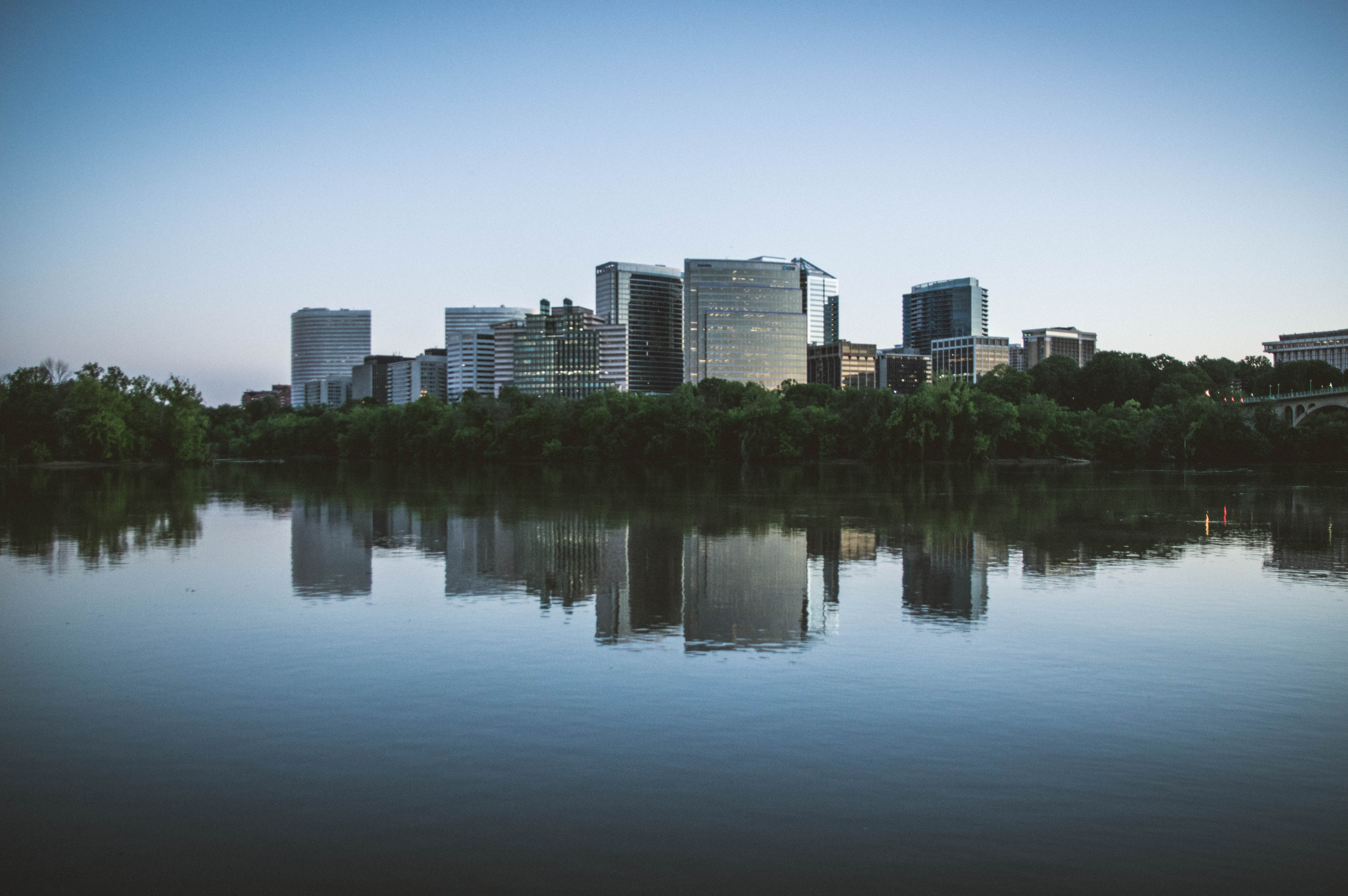buildings with reflection on water at daytime