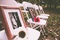 brown wooden photo frame on white folding chairs