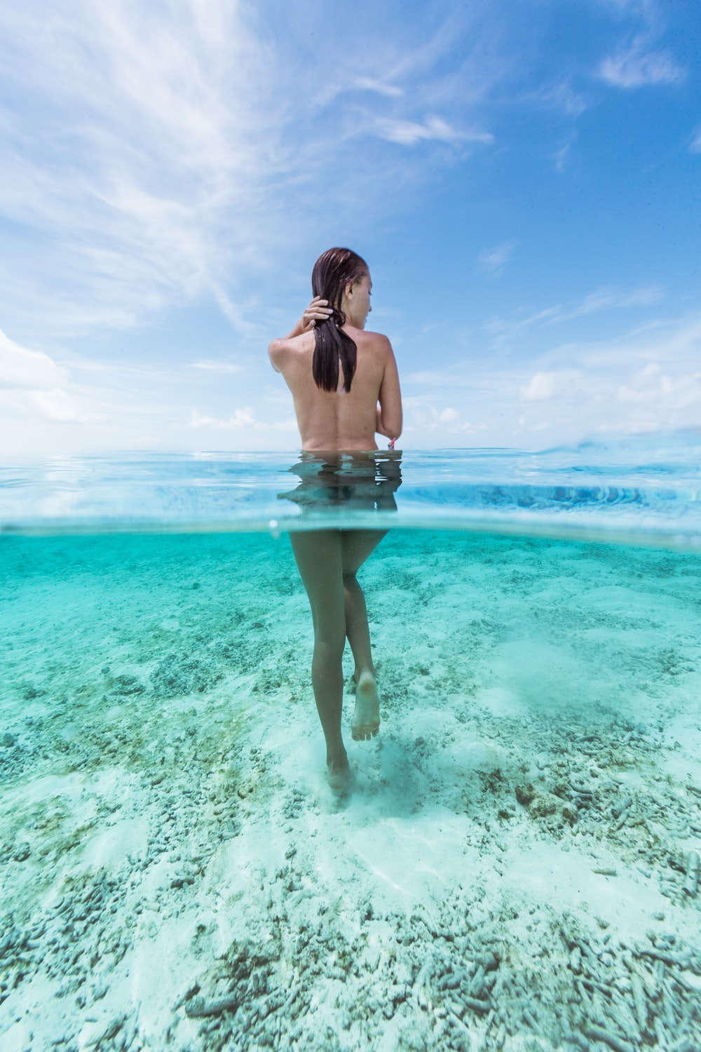 naked woman in water at daytime