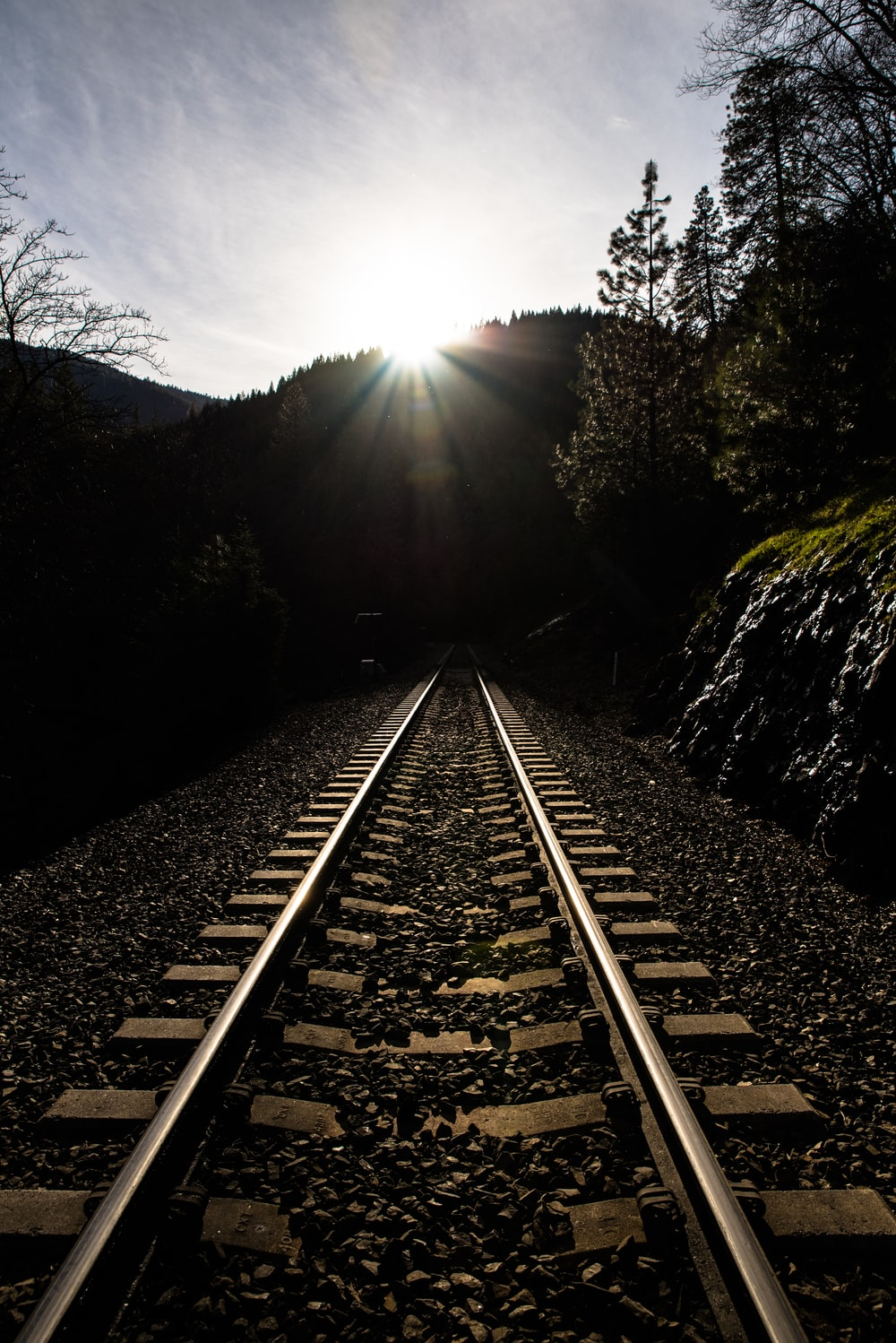 sun rays over the hills and railroad