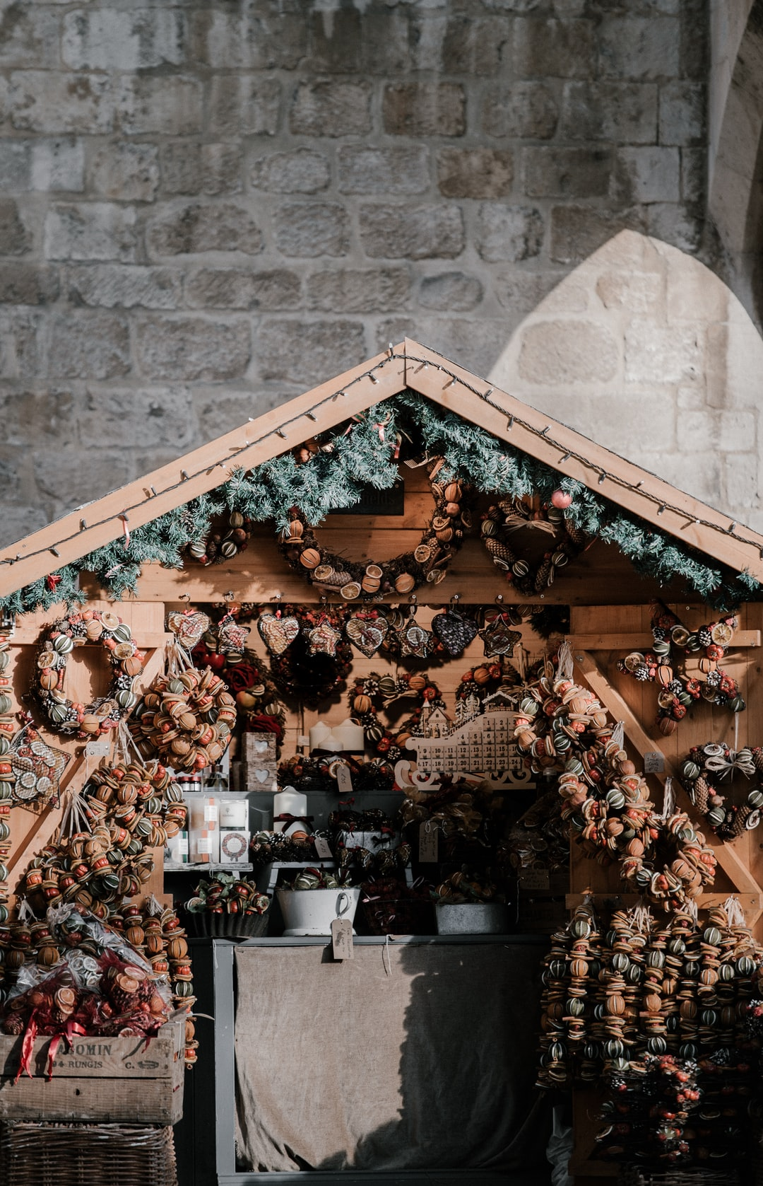 Christmas market stall with traditional dried orange wreaths - these smell AMAZING!