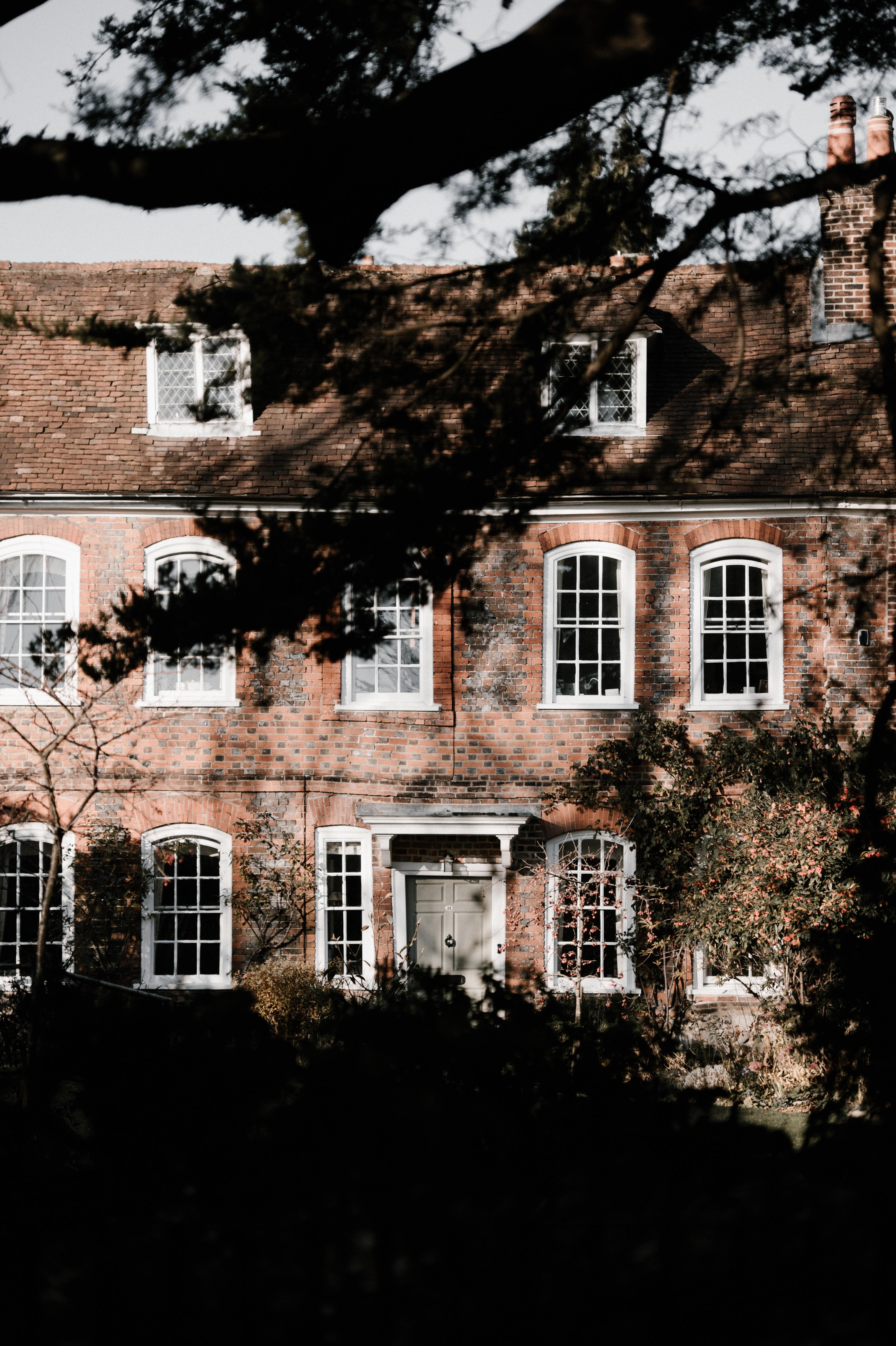 brown brick building near trees