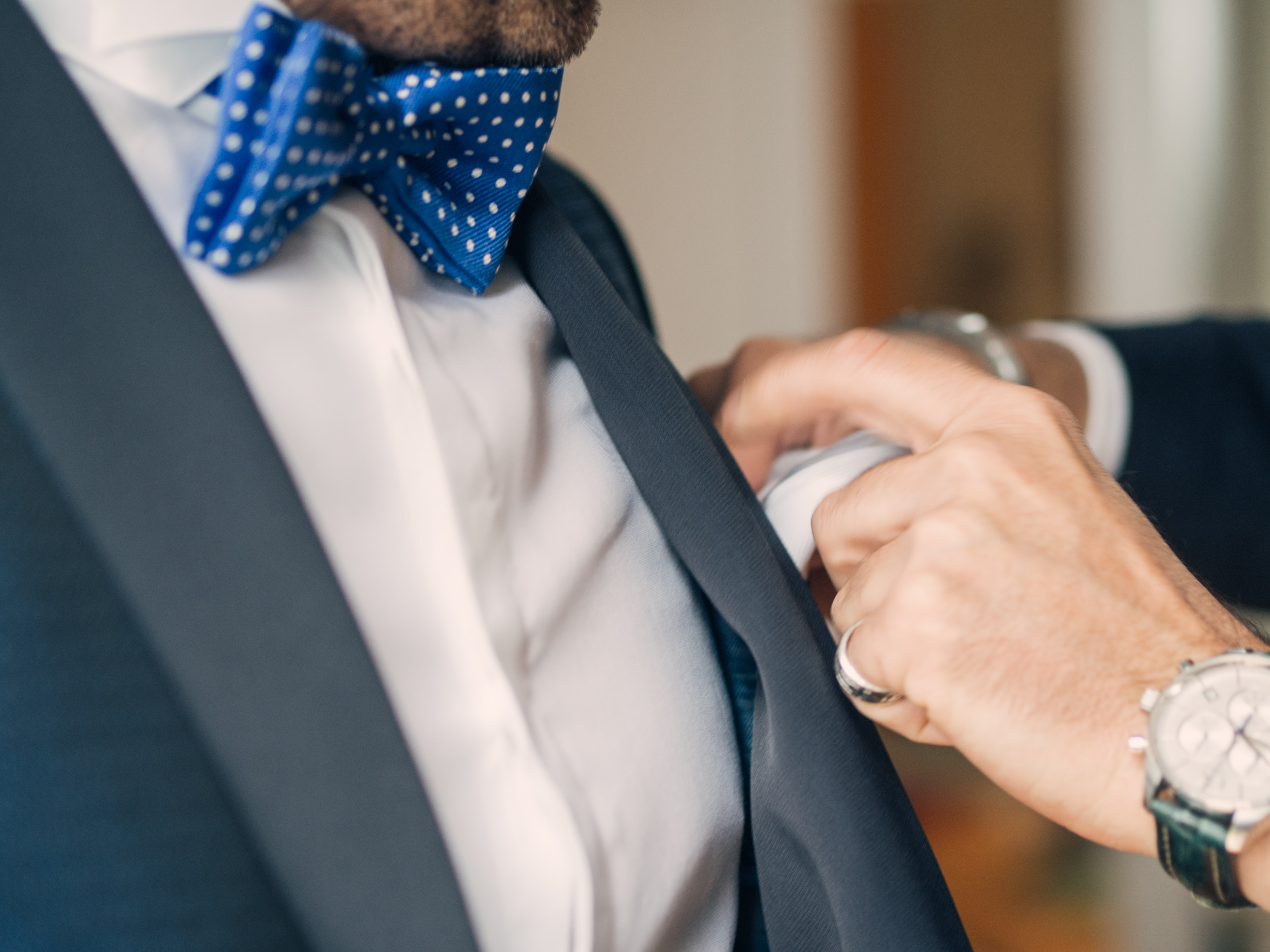 man wearing blue and white polka-dot bowtie
