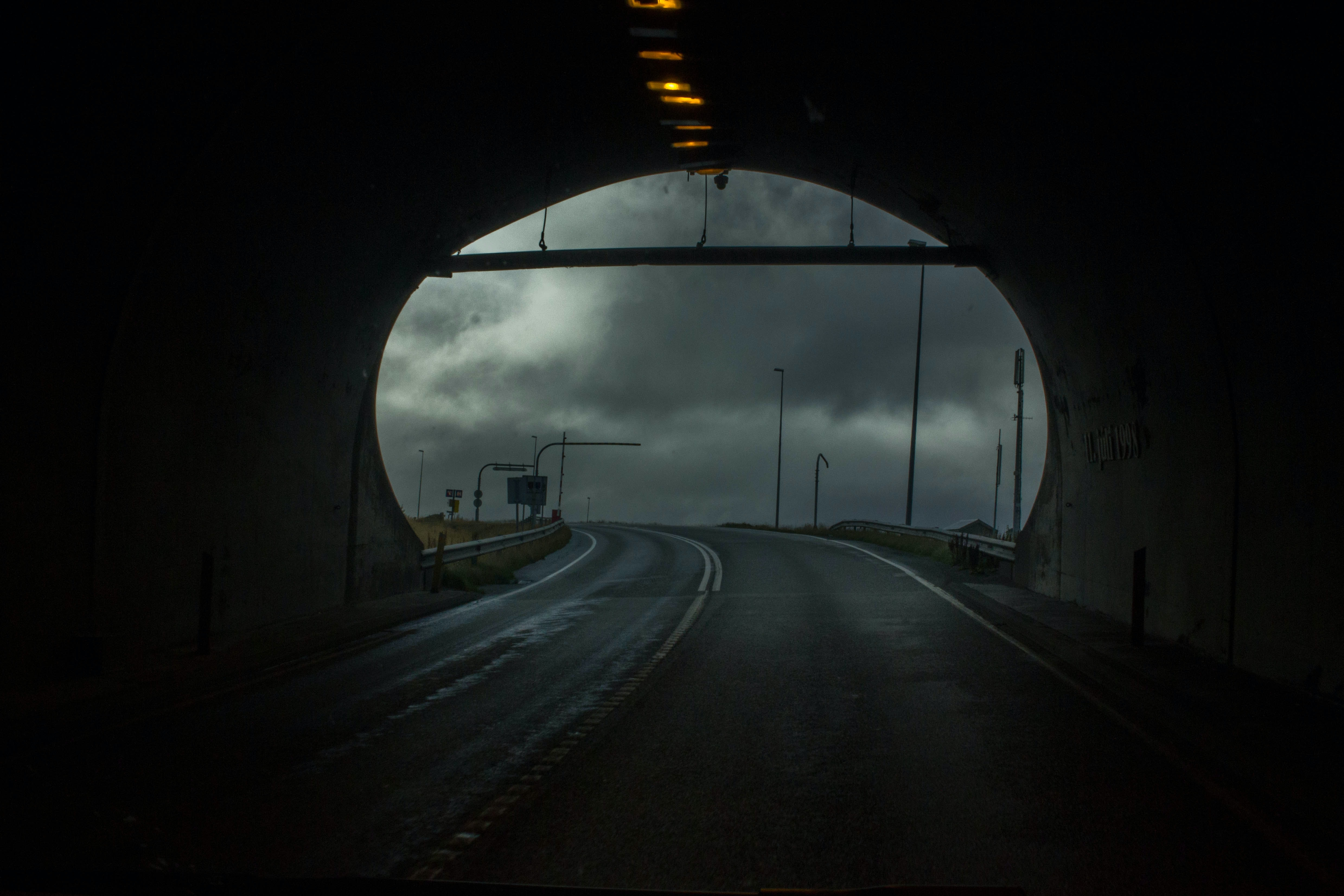 photo of empty pavement inside tunnel