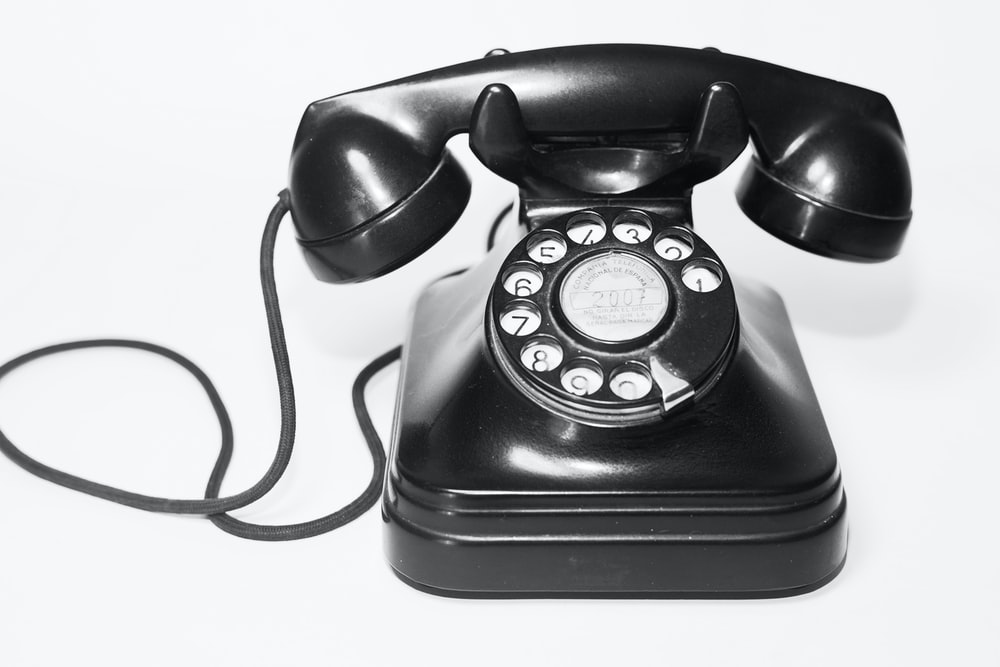 photo of black rotary telephone