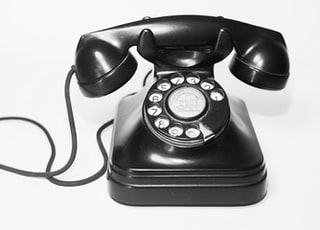 photo of black rotary telephone