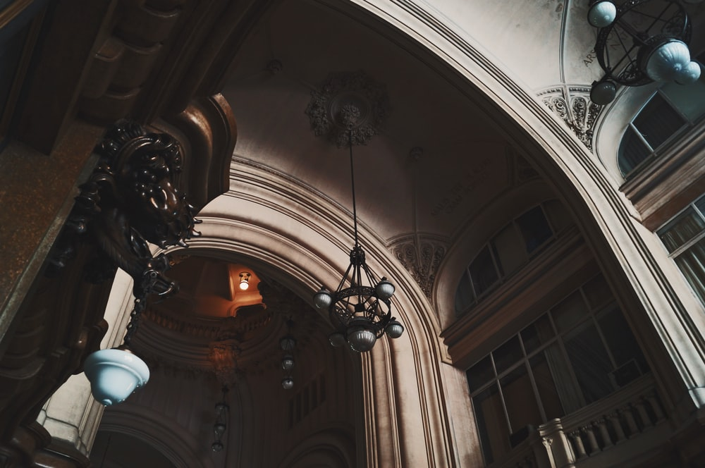 low angle photography of white arch ceiling of interior